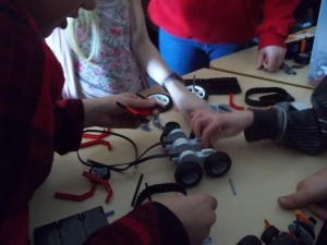 Kids learning how to build and program robots.